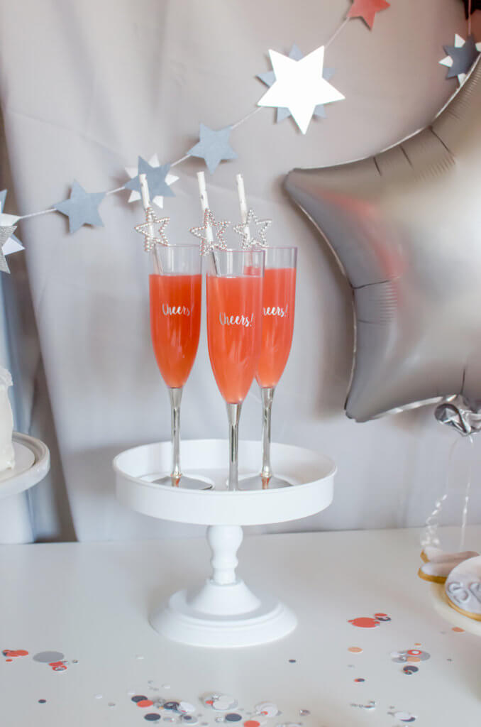 Coral sparkling drink for a Pantone inspired New Years Eve party