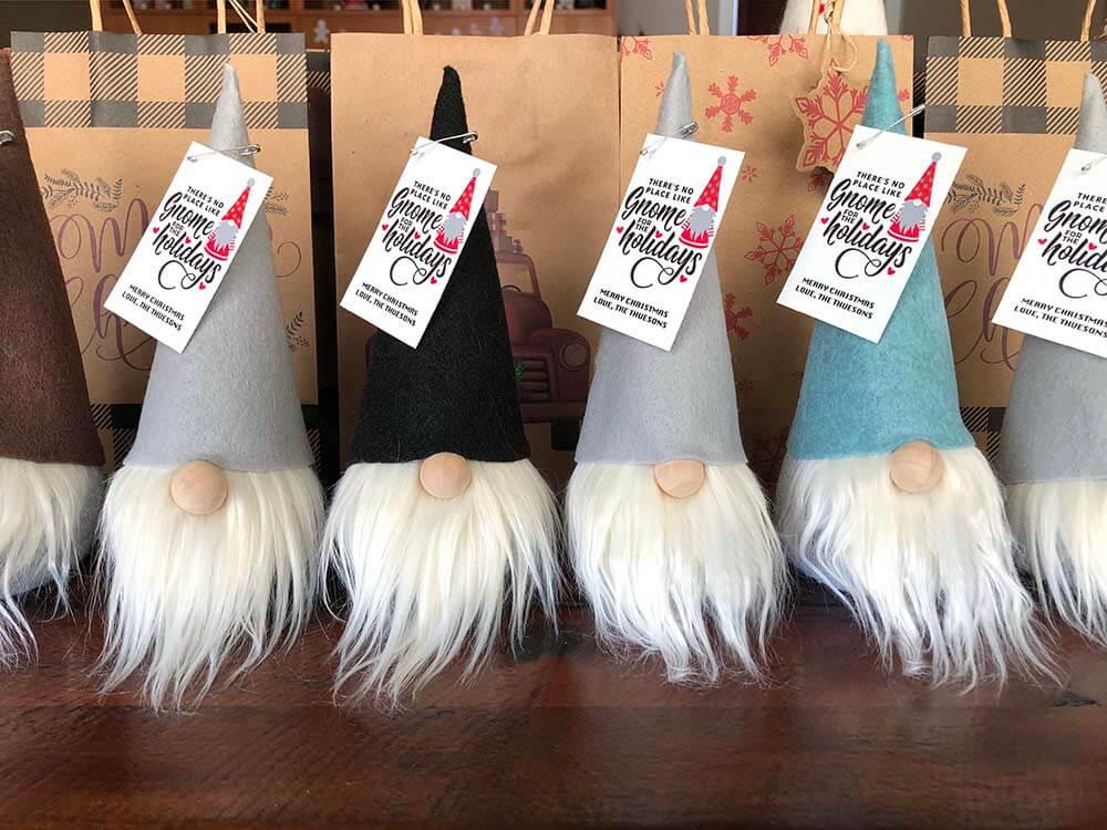 Line of handmade sock gnomes with gift tags