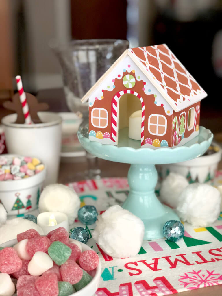 Wooden gingerbread house centerpiece for a Christmas Cookie Exchange Party