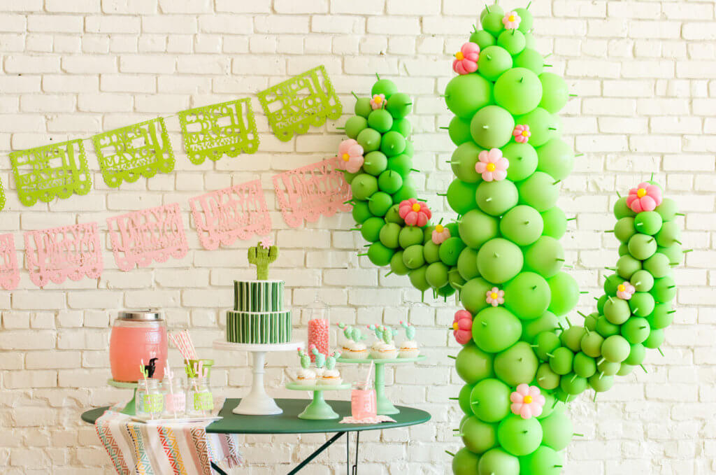 Cactus themed party display with balloon cactus for a top party trend
