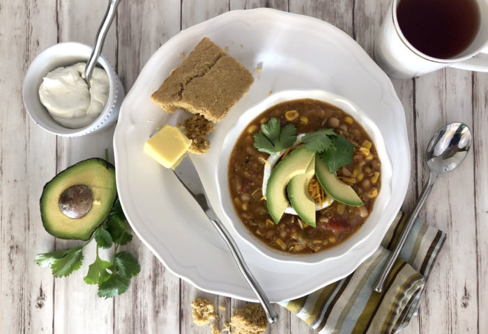 Flat lay white bean chicken chili recipe in bowl styled on table
