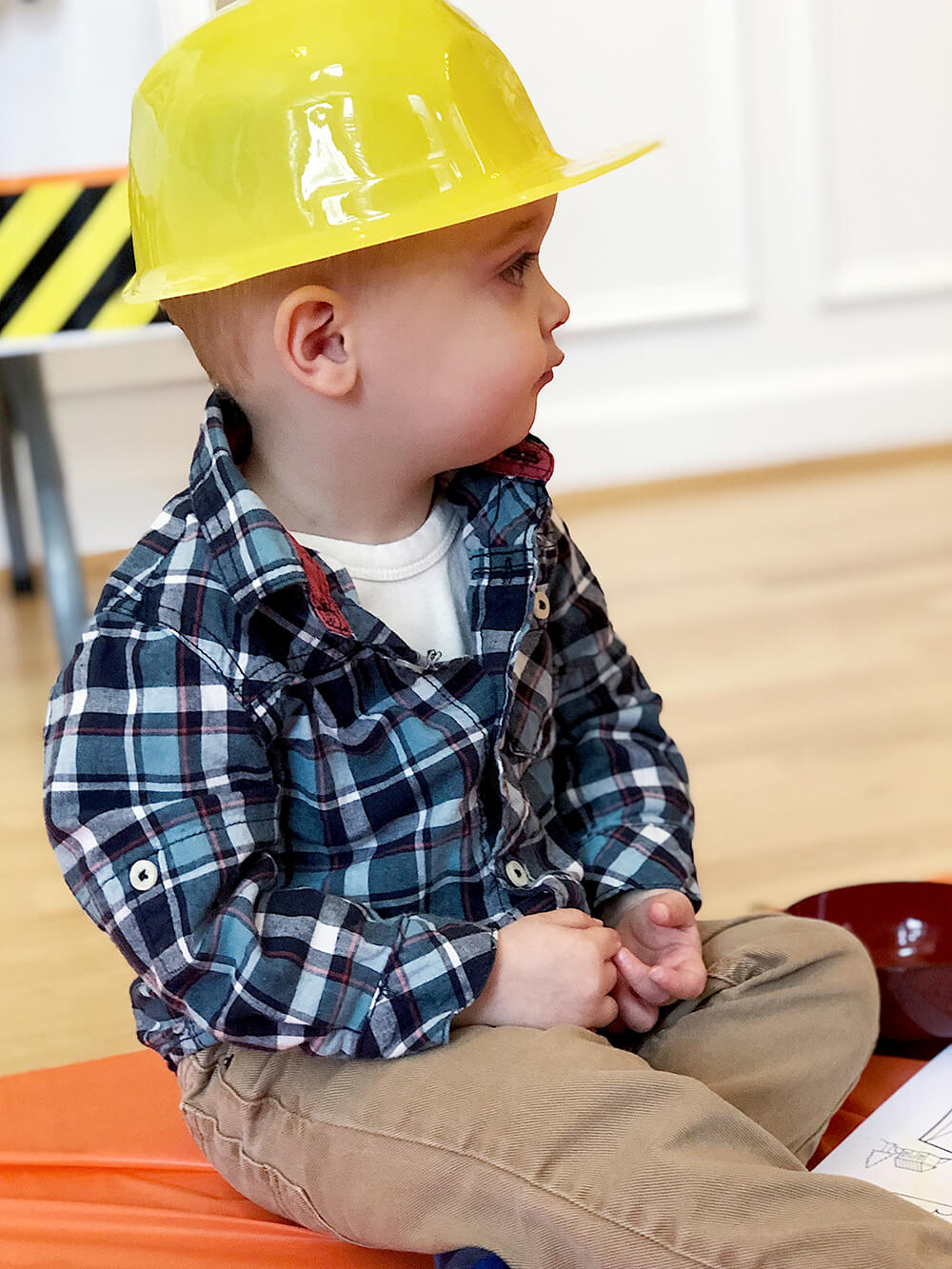 Birthday cutie in hard hat at Boys construction birthday party