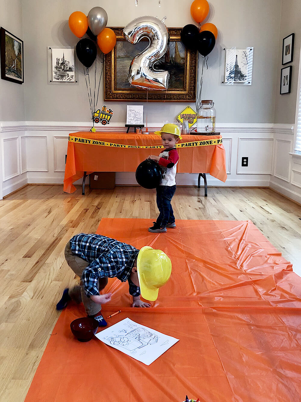 "Boys playing in the ""Hard hat area"" for a Boys construction birthday party"