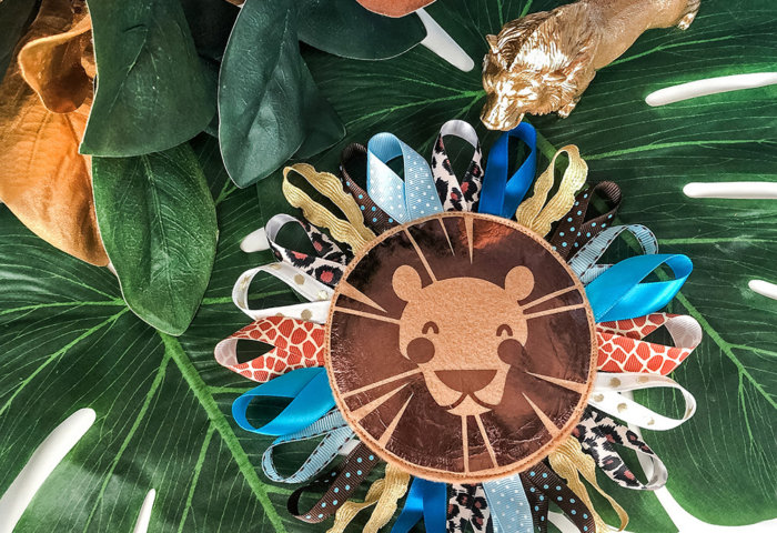 Lion Baby Tag Toy DIY on green leaves for Safari baby shower gift