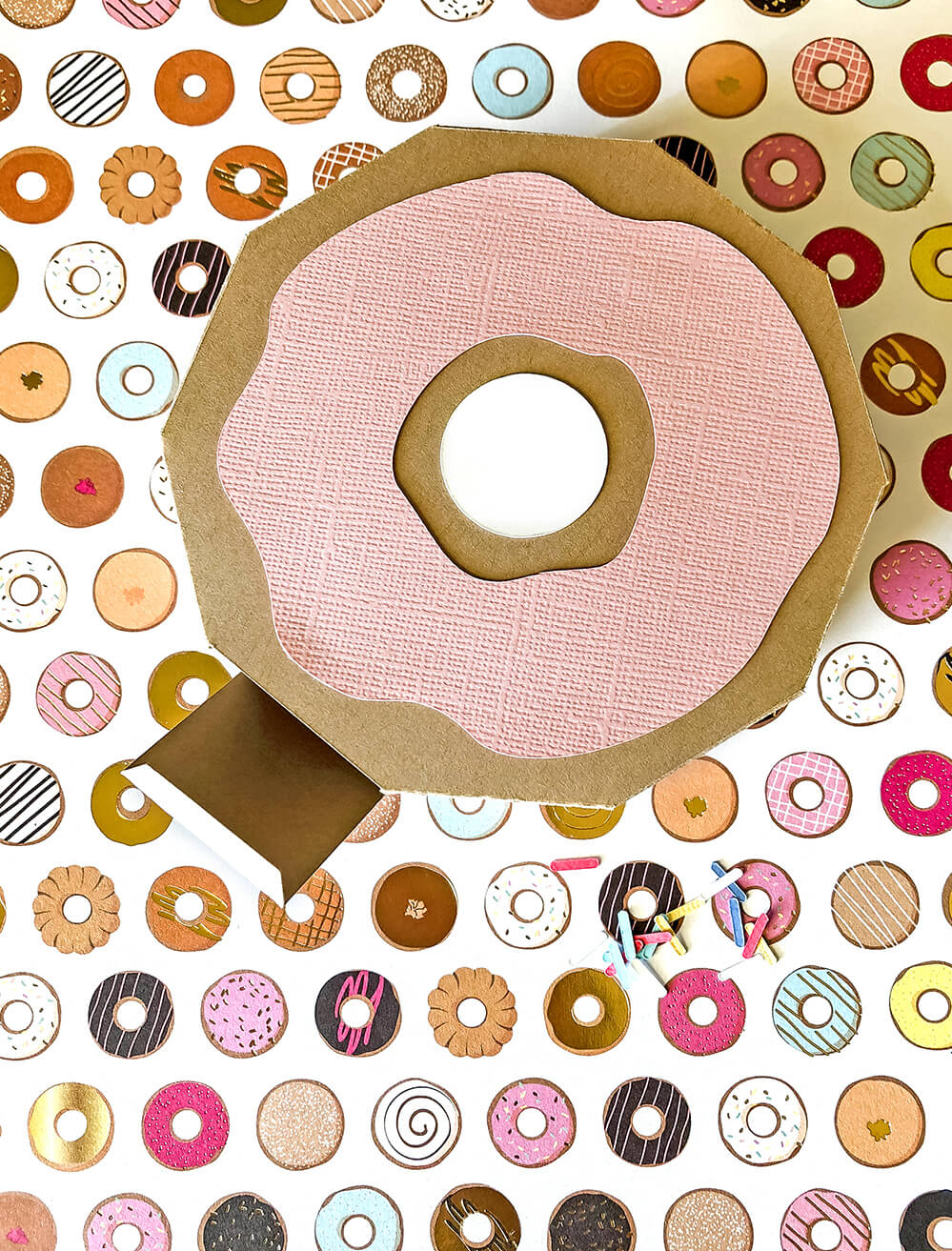 Glue frosting to a Donut party favor box