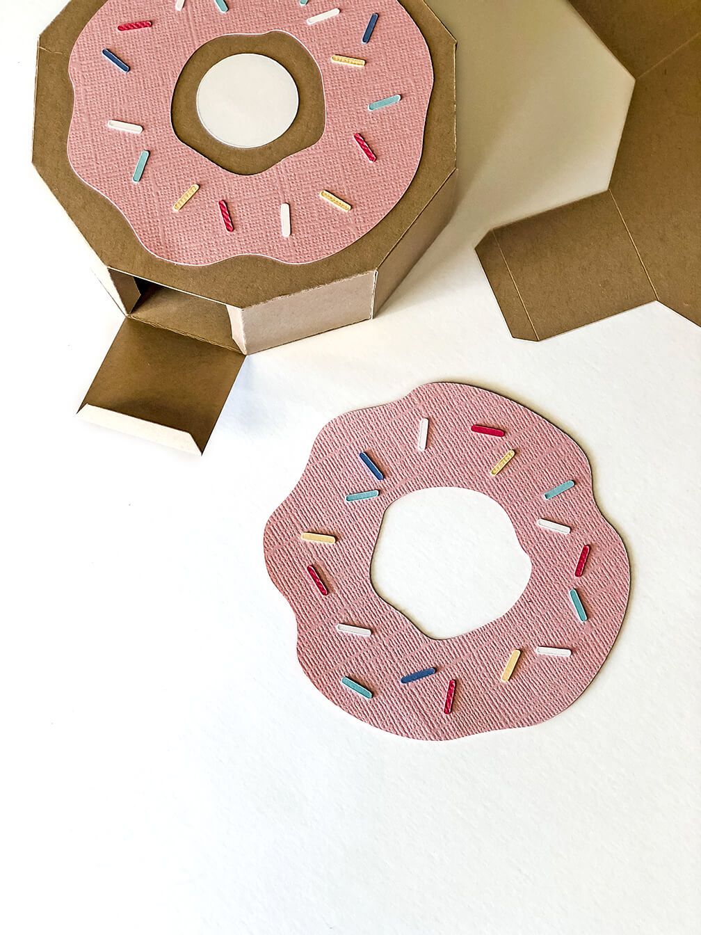Add sprinkles to the frosting for a Donut party favor box