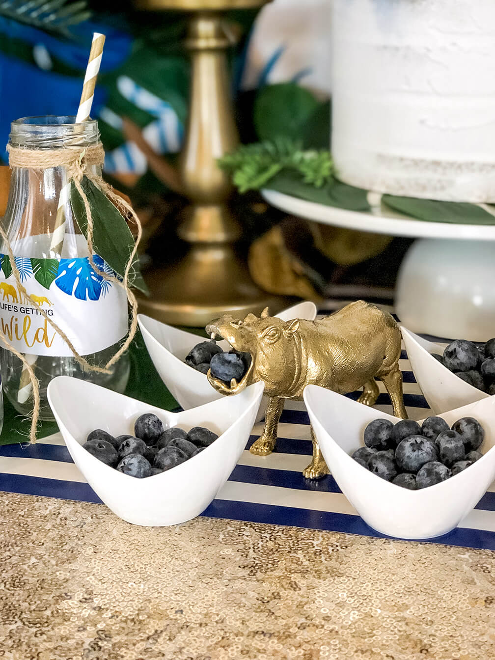 Jungle party hippo eating blueberries at a glam safari baby shower