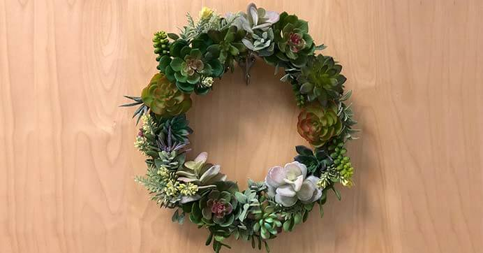 Succulent wreath on wood surface - pinspiration for succulent wreath tutorial