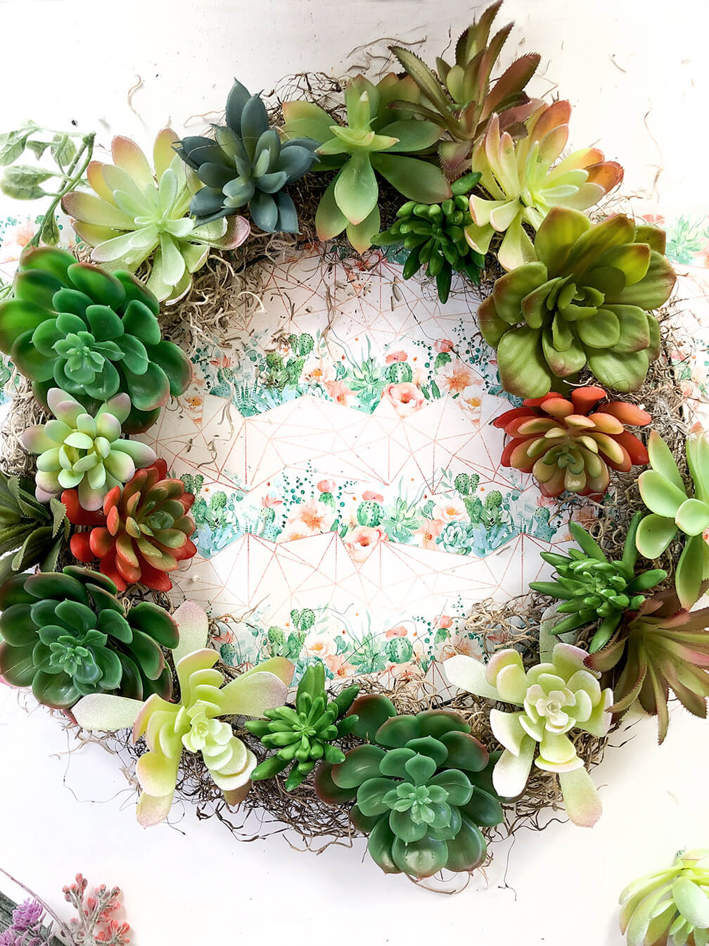 Filled in gaps with smaller plants during a succulent wreath tutorial