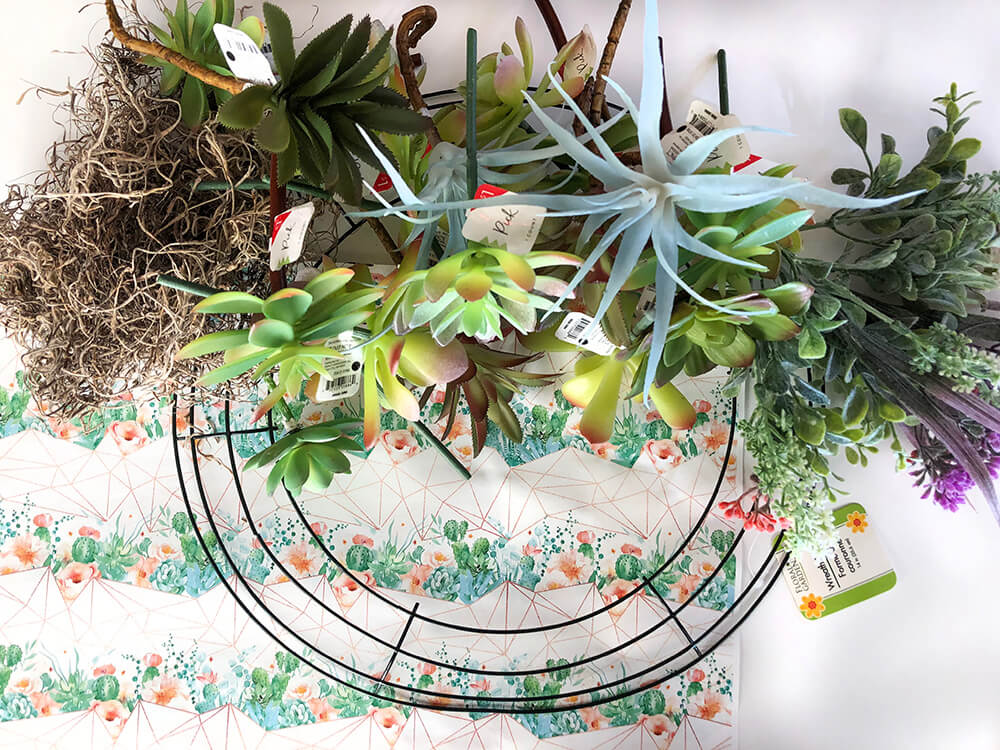 supplies on table for dollar store succulent wreath tutorial