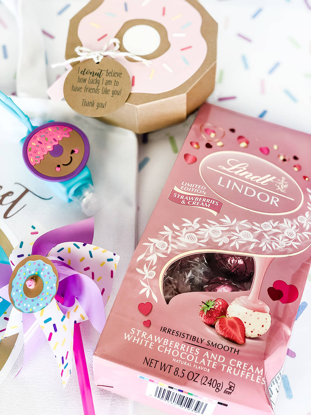 Donut party favor box and other sweet treats for a sprinkle
