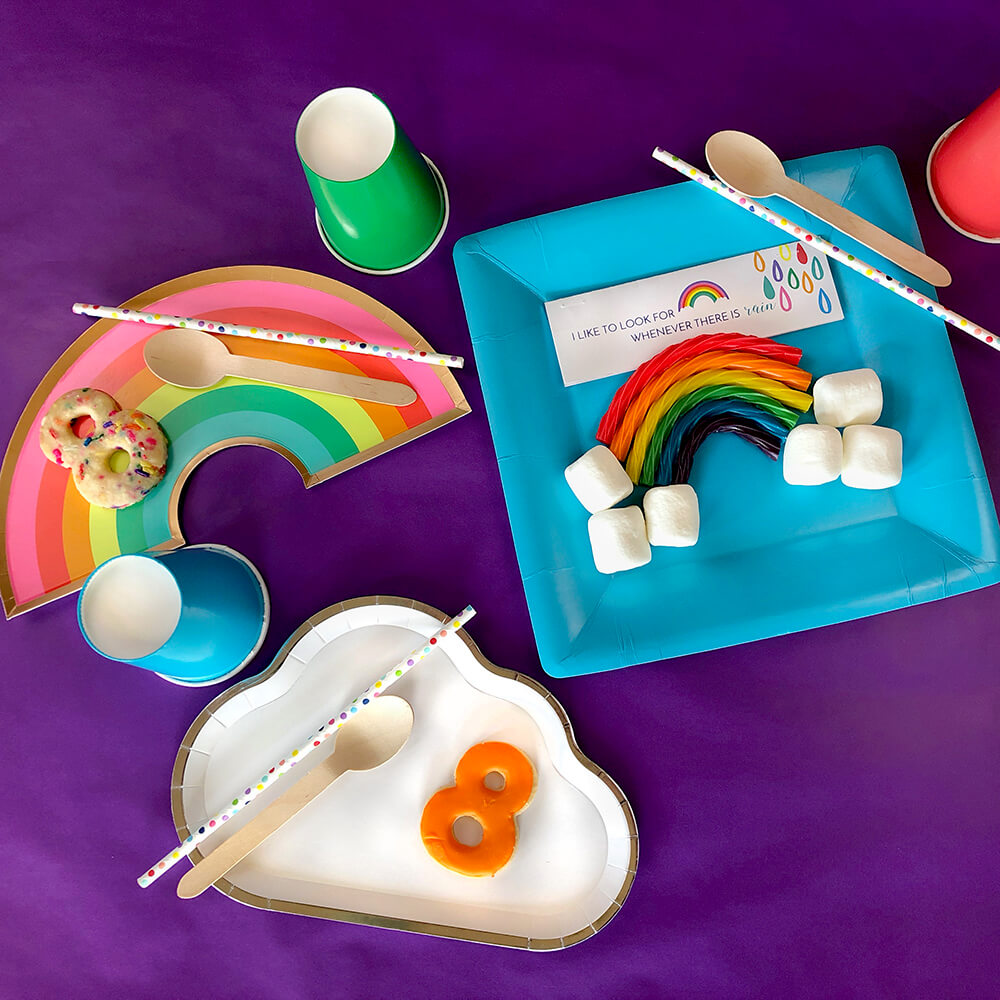 Brightly colored paper goods and favor for over the rainbow party