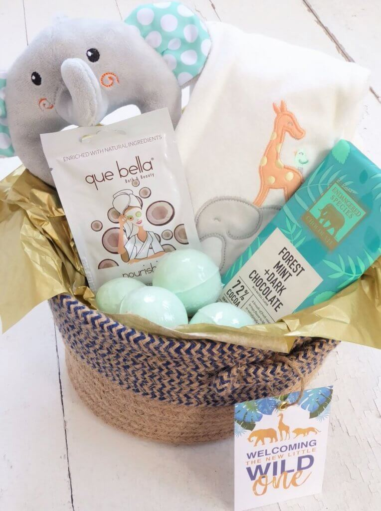 Gift basket of jungle themed items for a glam safari baby shower