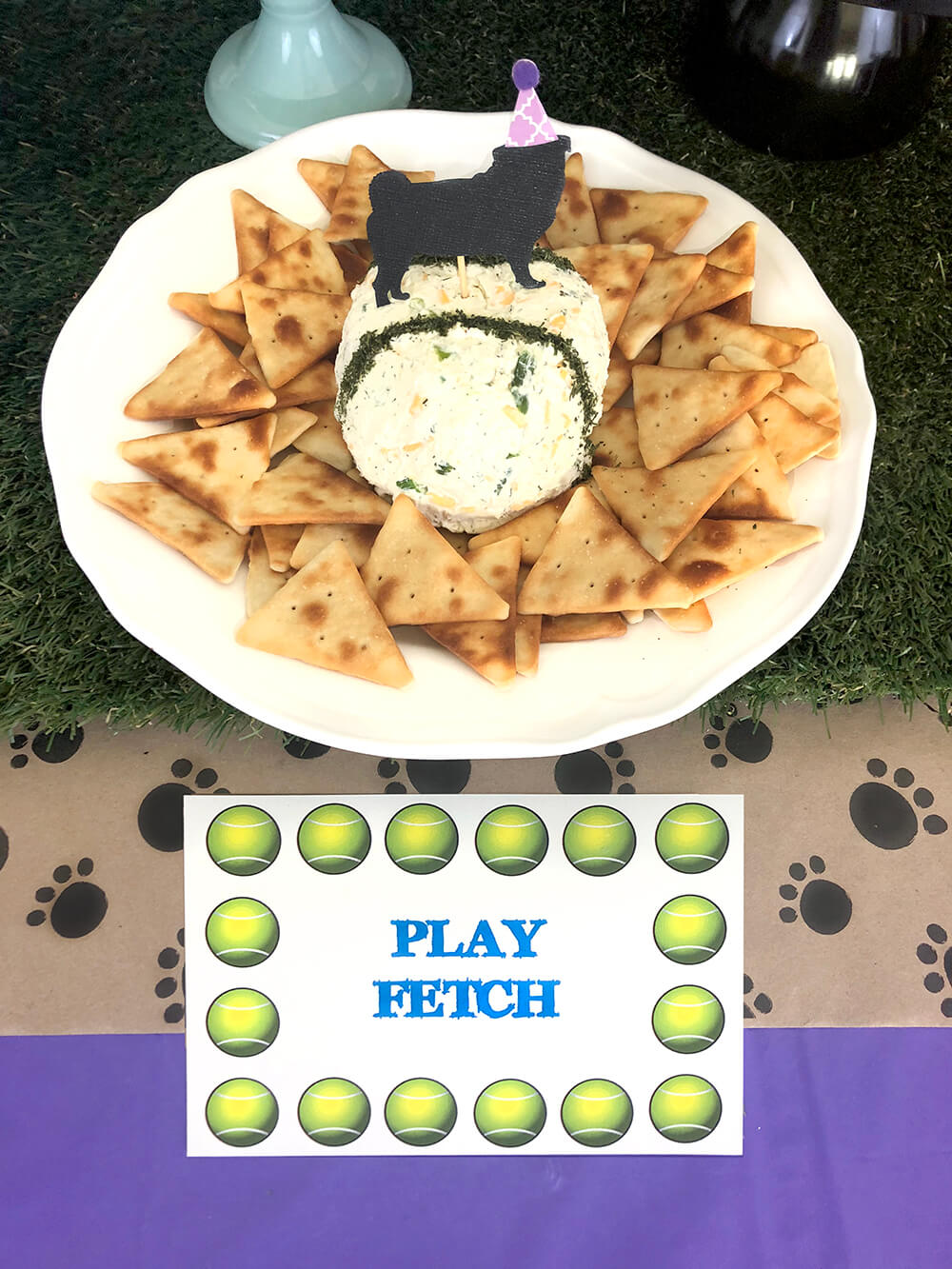 Cheese tennis ball with pita chip crackers - Puppy Themed Birthday Party Food Ideas