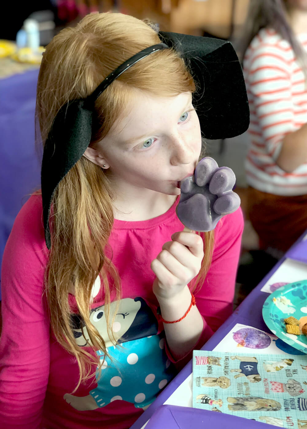 Girl eating berry pupsicles - Dog Themed Puppy Birthday Party Ideas