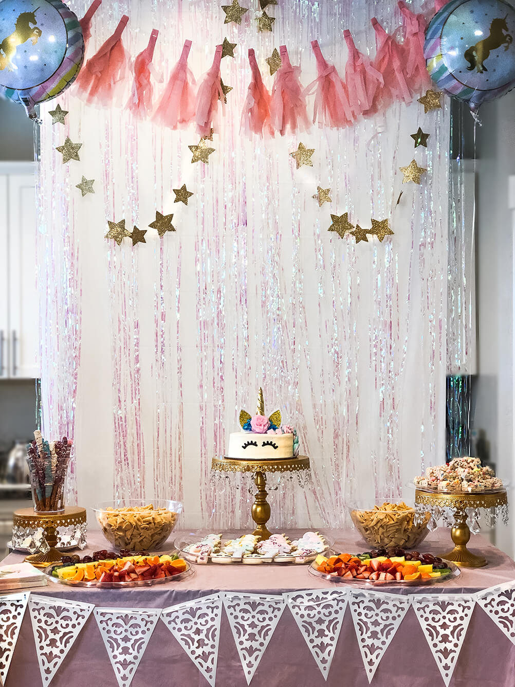 Food table Unicorn themed birthday party ideas