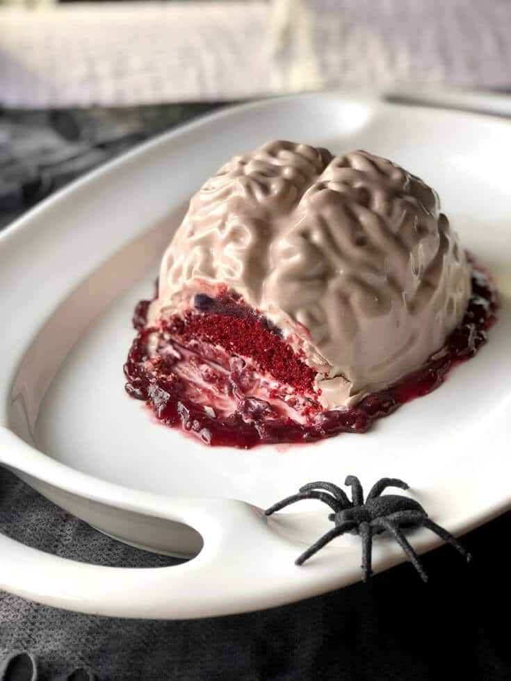 The first slice of a red velvet Brain Cake