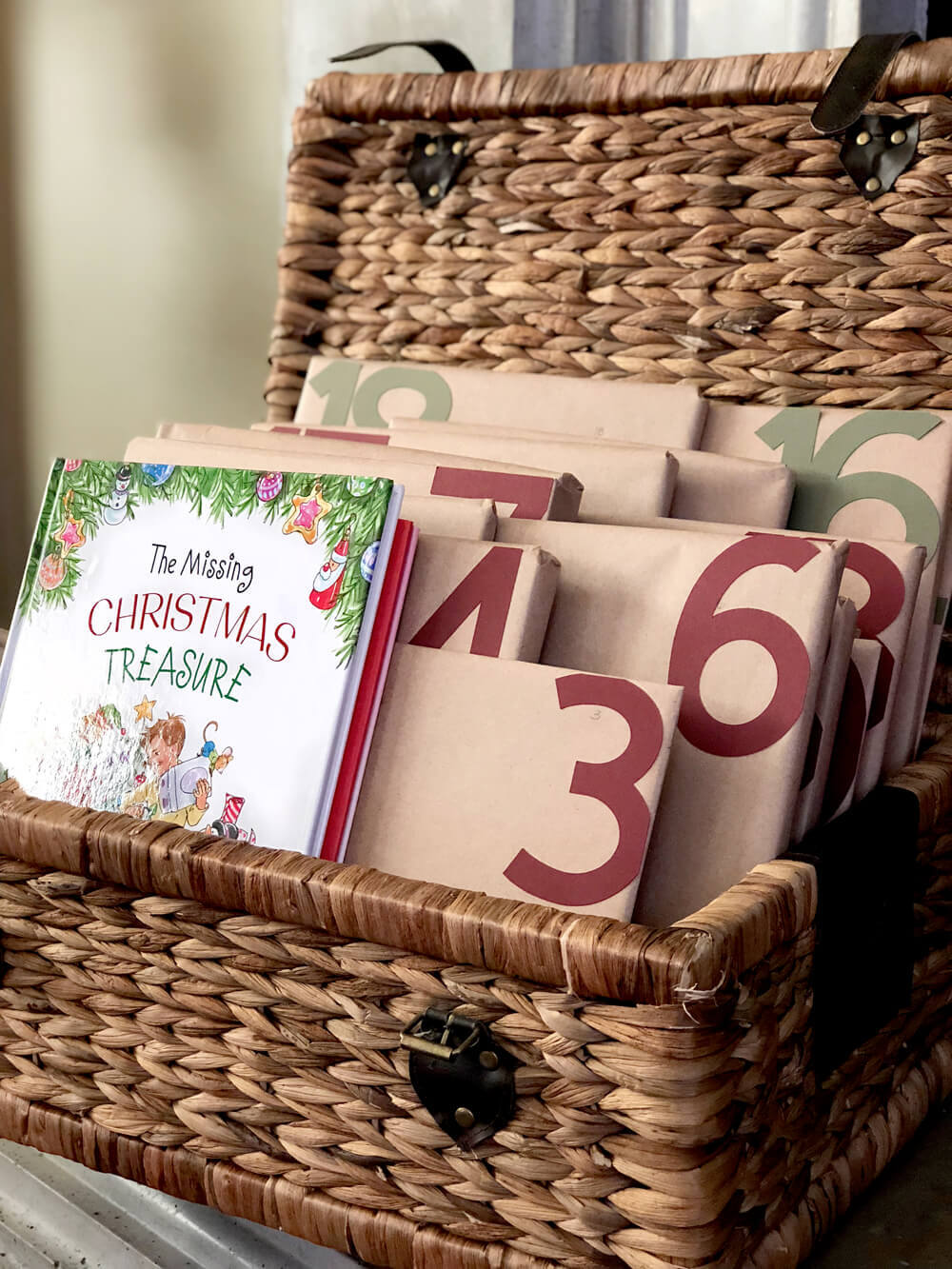 Basket full of books marked for each day counting down to a rustic woodland Christmas