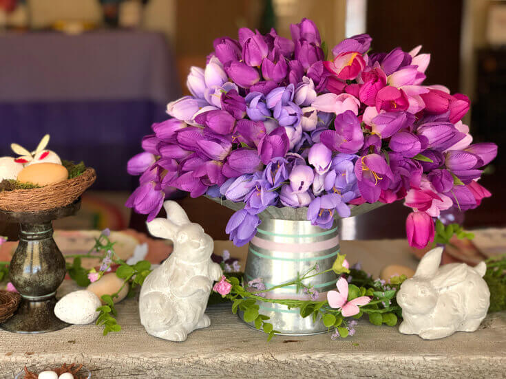 Easter centerpiece with purple tulips and ceramic bunnies
