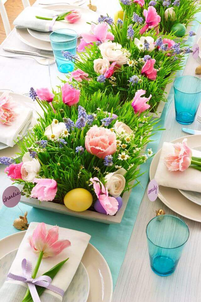 Halfpint Design - This bright centerpiece doesn't feel overwhelming by using neutrals for the rest of the tablescape