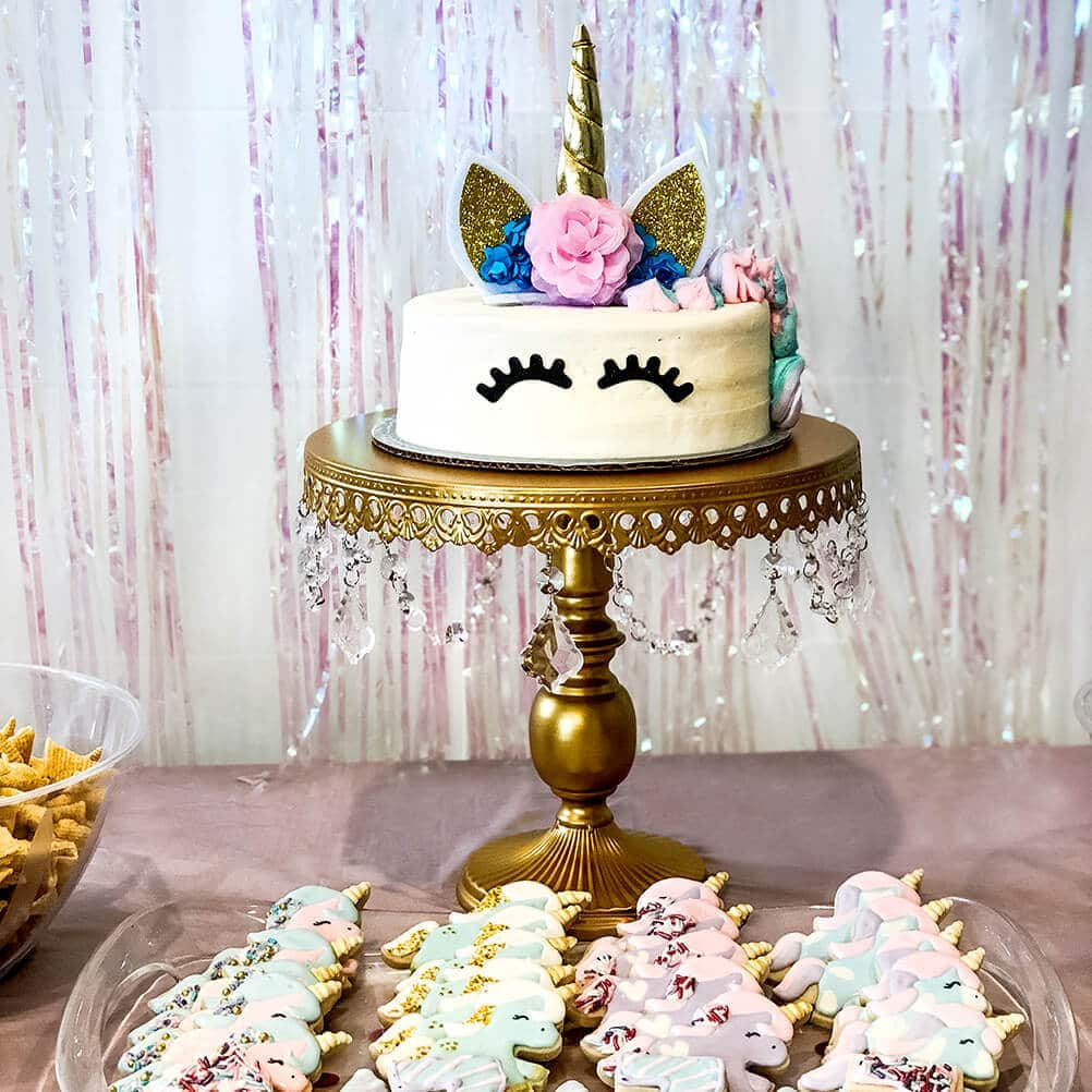 Unicorn in a field of horses Unicorn themed birthday party ideas