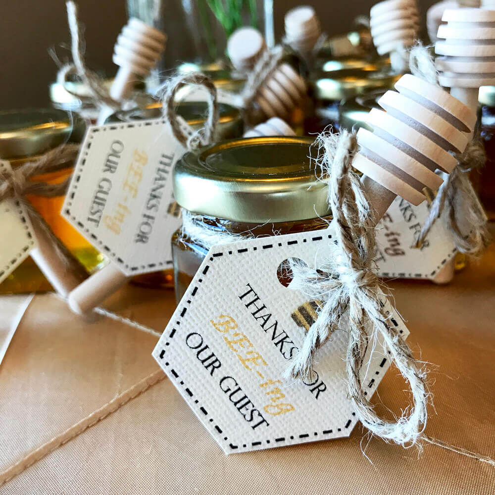 Babies breath centerpiece in mason jar with bit o honey treats at Mommy to Bee baby shower