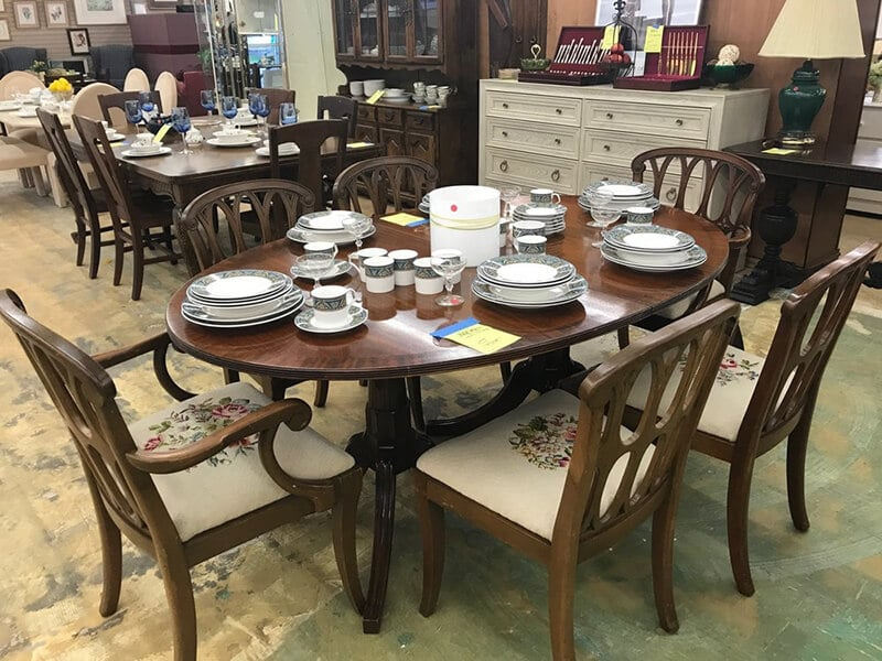 Table set with dishes at ReStore non-profit thrift store