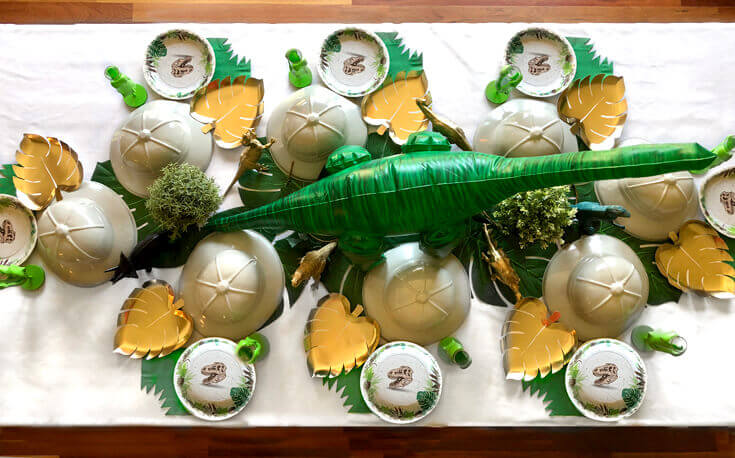 Dinosaur party table with inflatable dino centerpiece