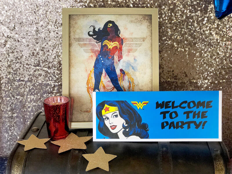 Gold sequin backdrop, number 40 balloons, red stars for Wonder Woman birthday party