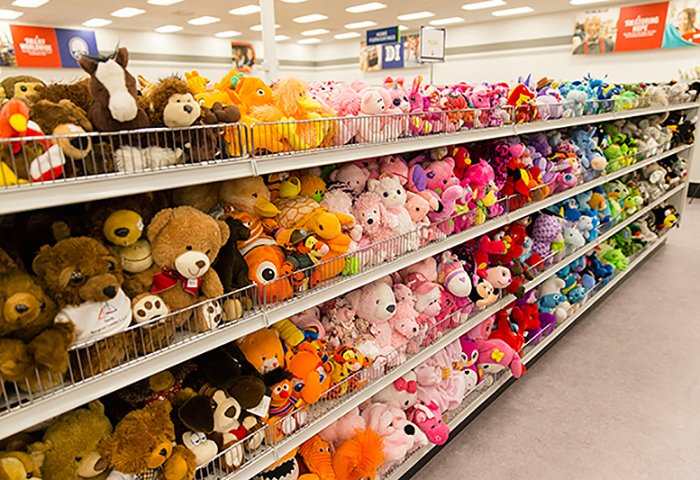 Stuffed animals arranged in rainbow order at Deseret Industries non-Profit Thrift Store