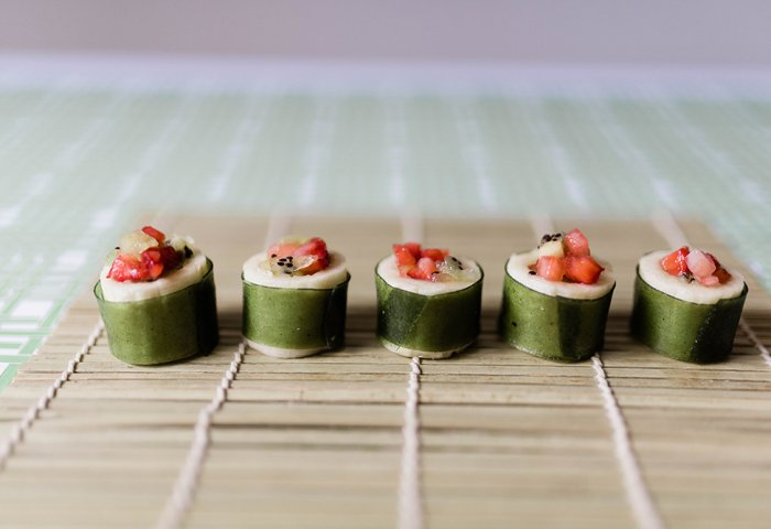 Finished fruit sushi on bamboo mat