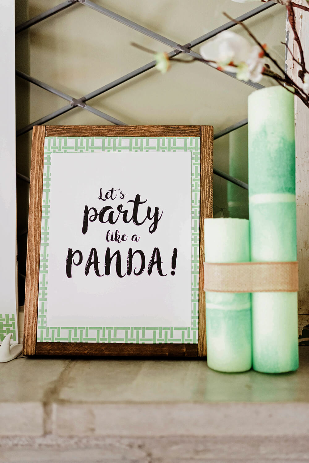 Let's party like a panda graphic on mantel