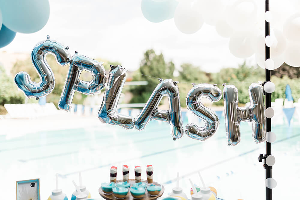Splash balloons as pool party backdrop