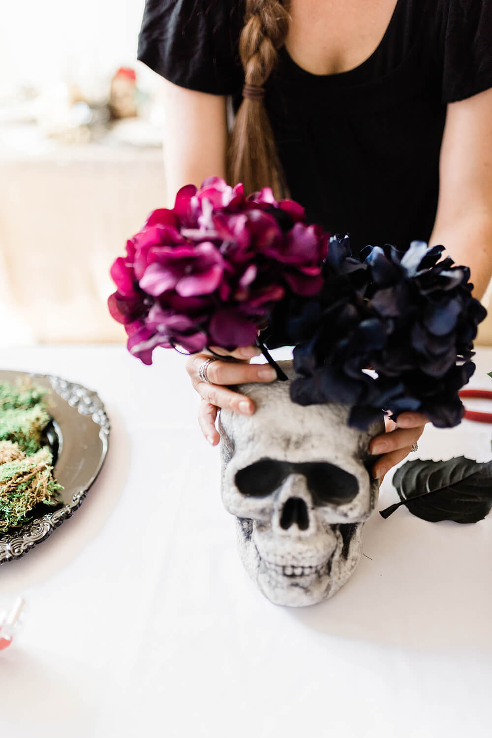 Adding flowers to skull for centerpiece