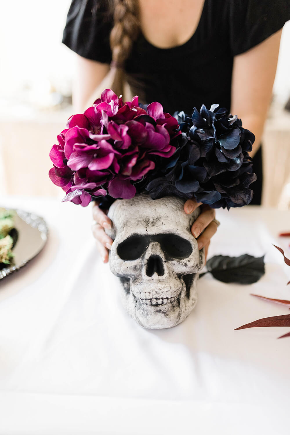 Balance the flowers on the skull for Halloween centerpiece
