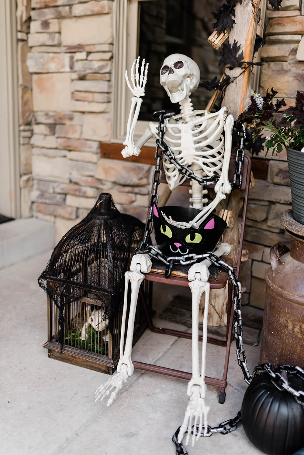 Skeleton candy bowl guard front porch decoration
