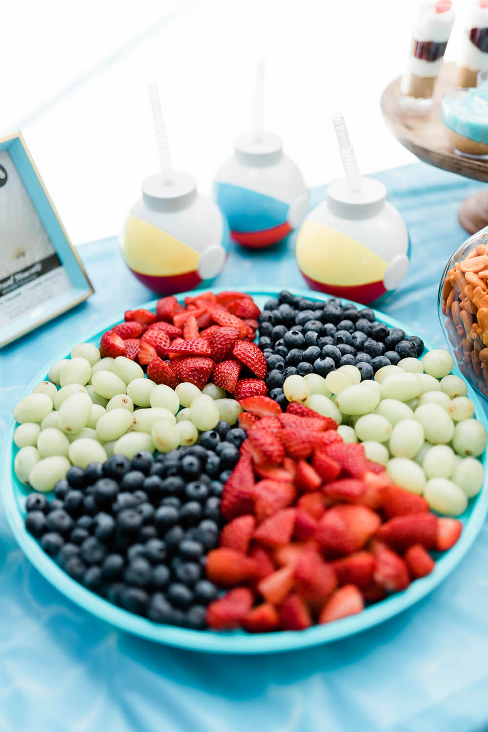 Healthy pool party treat fruit tray in the shape of beach ball