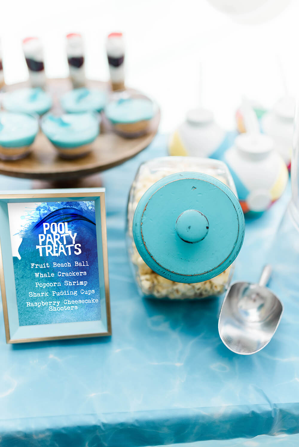Pool party treat menu next to canister of popcorn