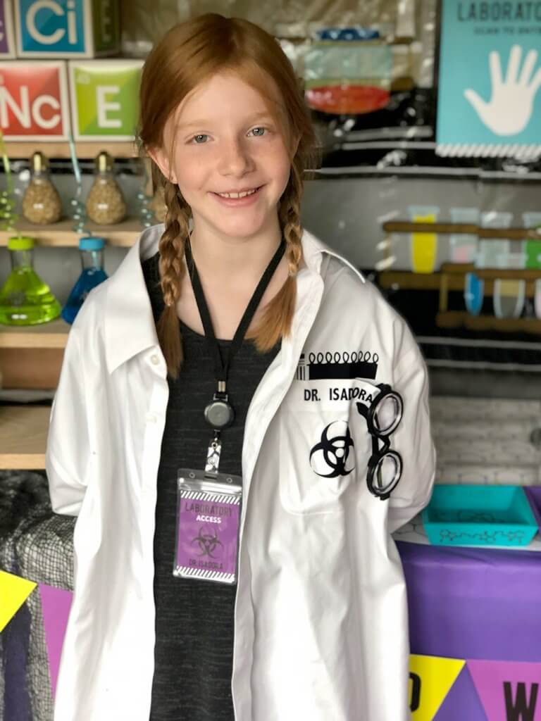 Girl in white lab coat at Mad Science party