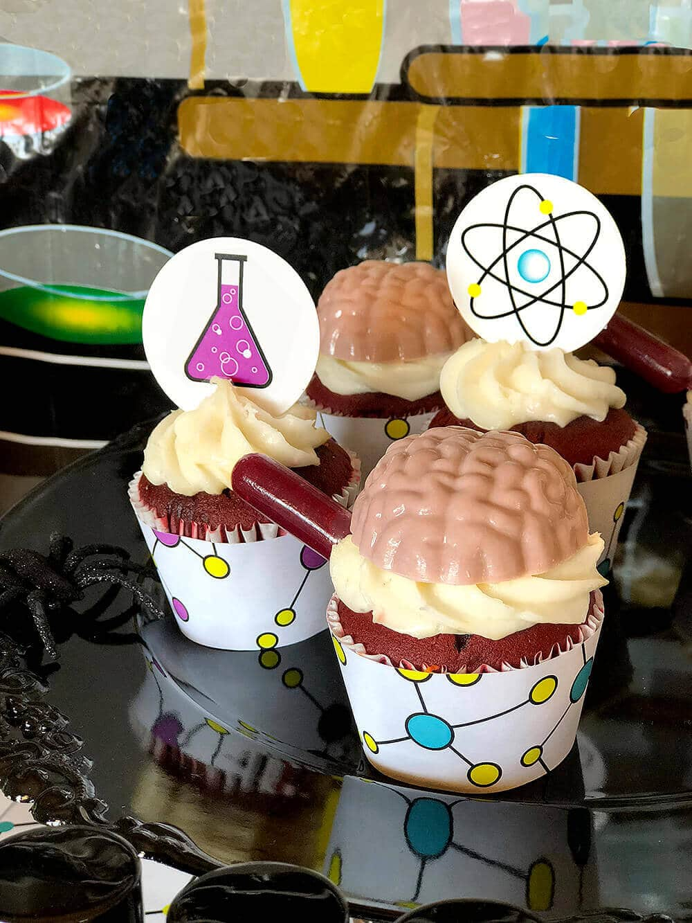 Brain, beakers, and atom toppers for mad science party cupcakes