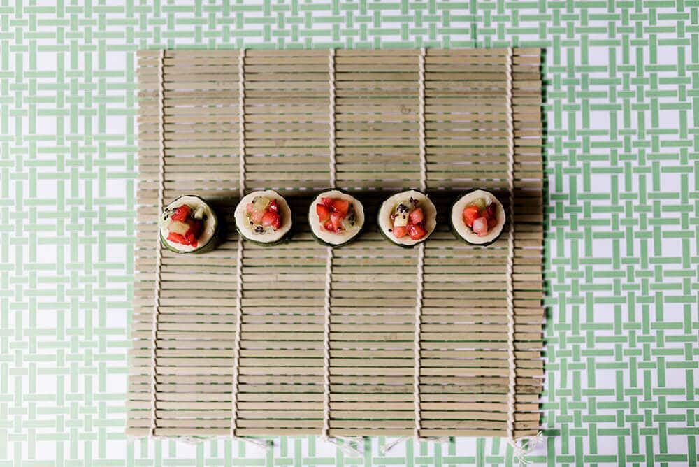 Finished sushi on bamboo mat for Simple Fruit Sushi Tutorial