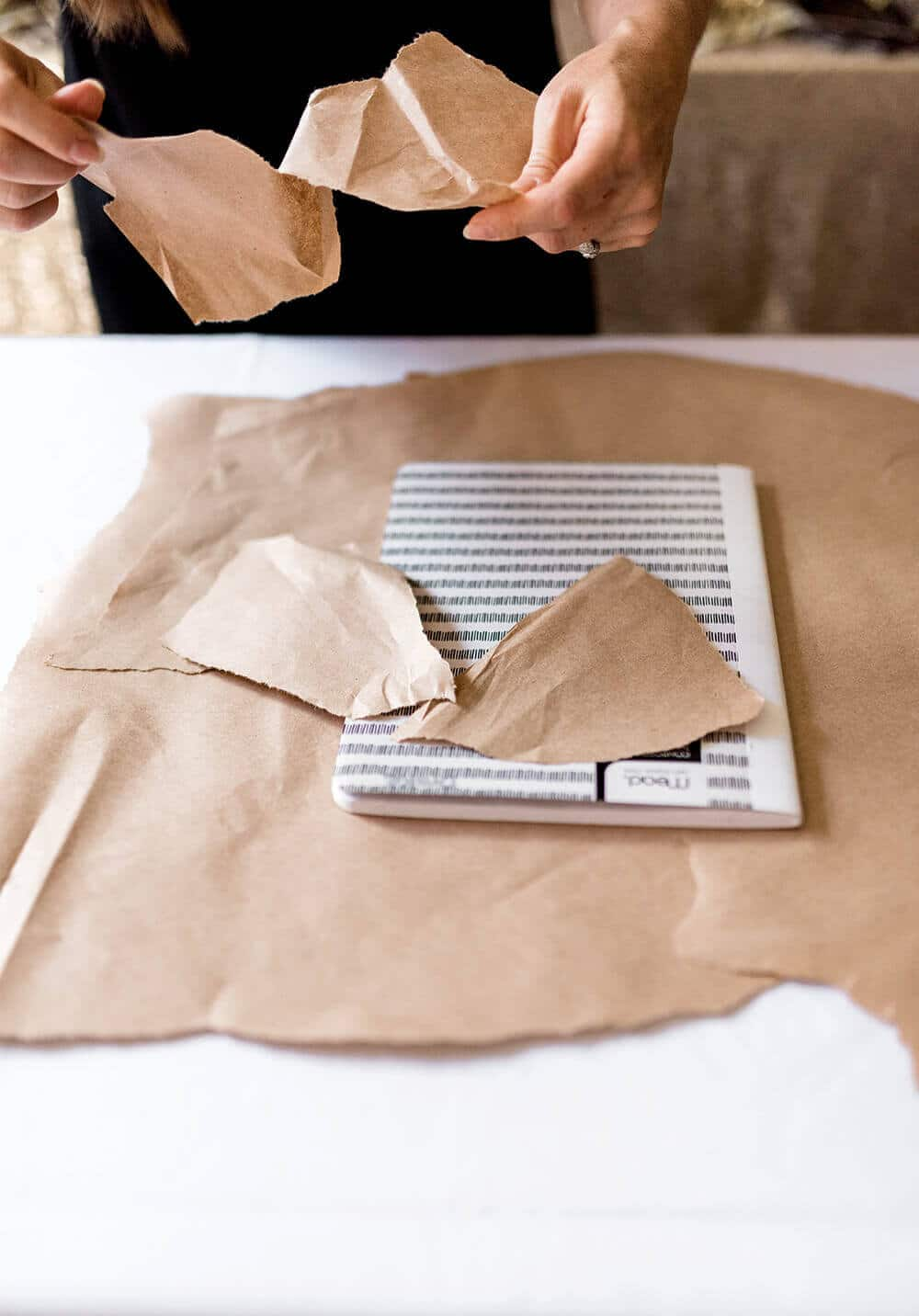 Tear pieces of paper to fit on cover