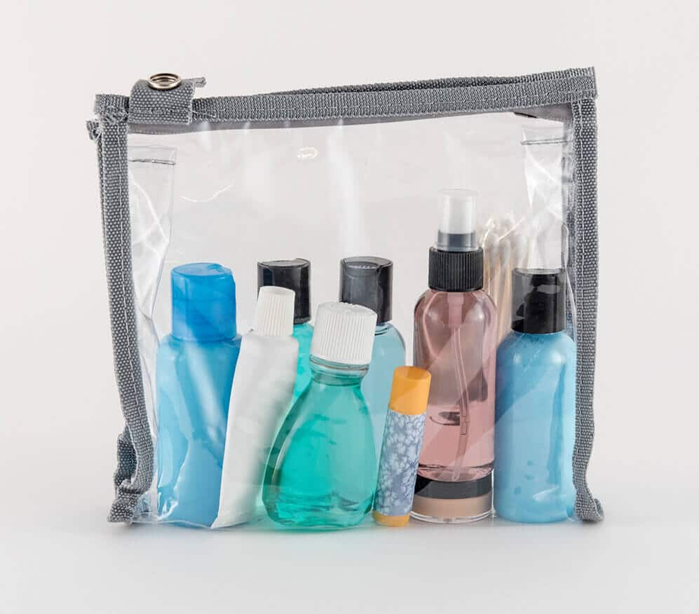 Clear toiletry bag with unused hotel toiletries