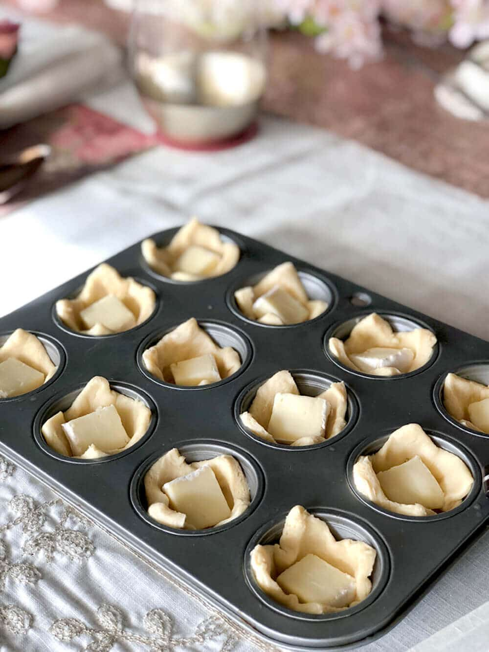 Cubed brie cheese in muffin tins