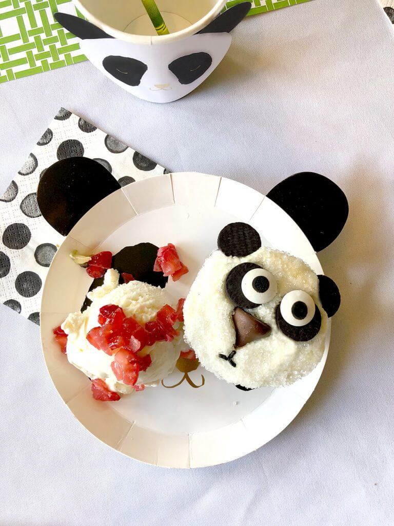Panda cupcake on plate with ice cream and strawberries