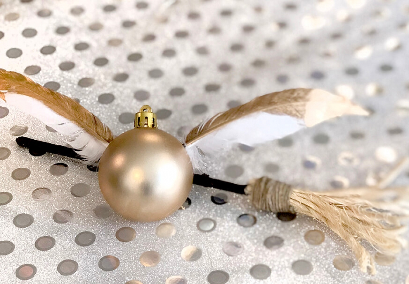 Golden snitch ornament and broom
