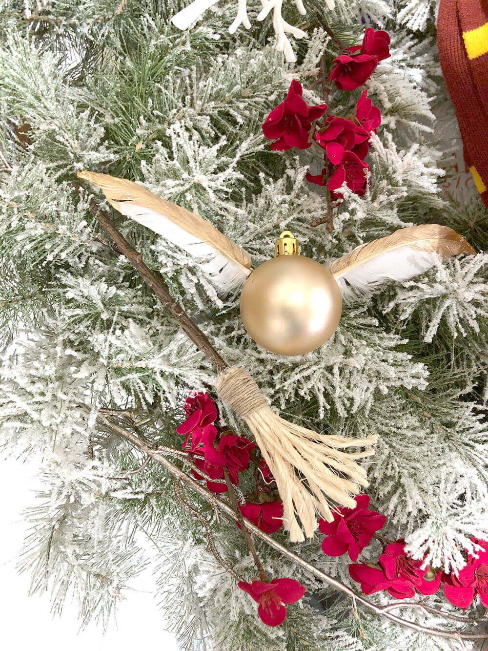 Golden snitch ornament on Christmas wreath