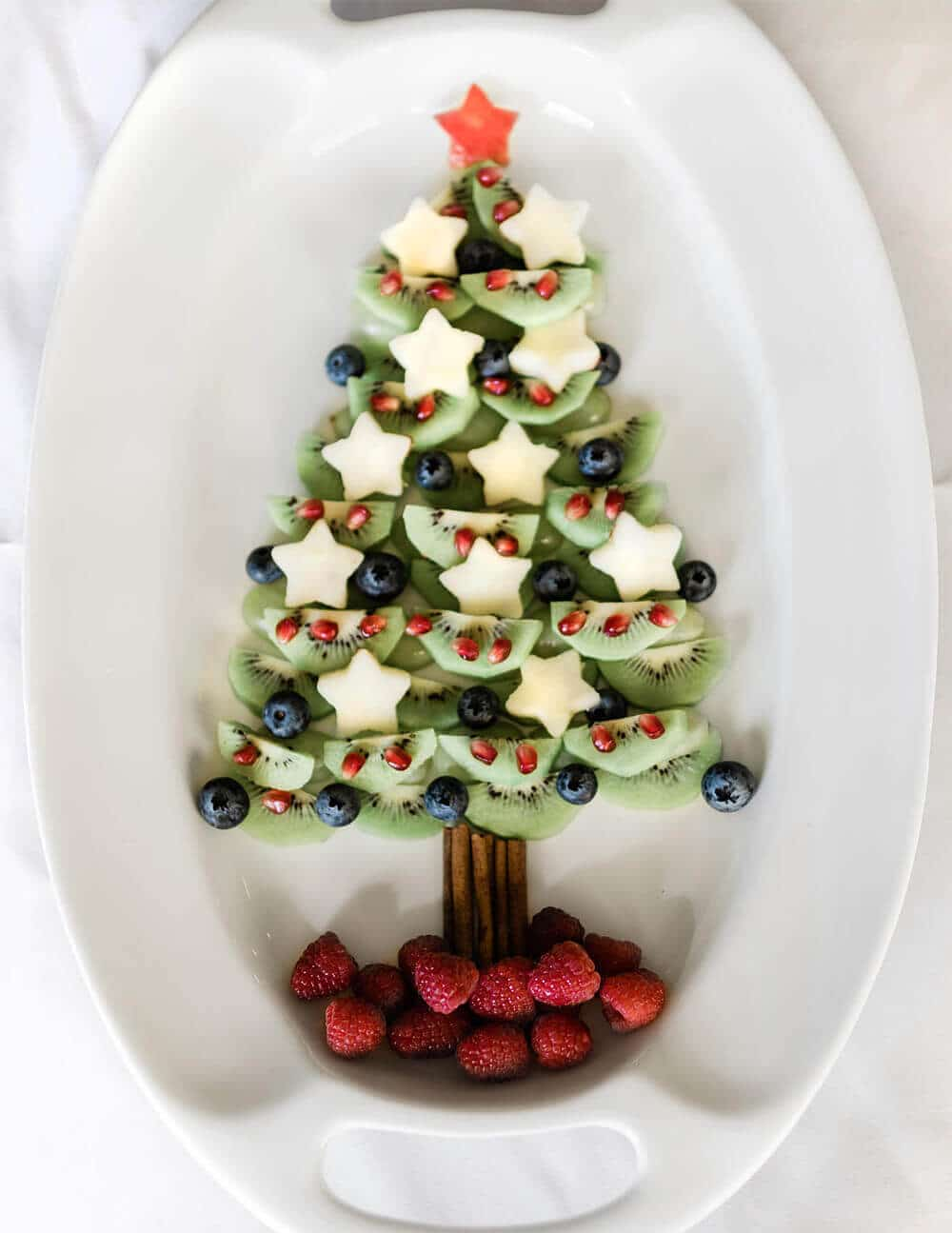 Finished fruit Christmas tree on white party platter
