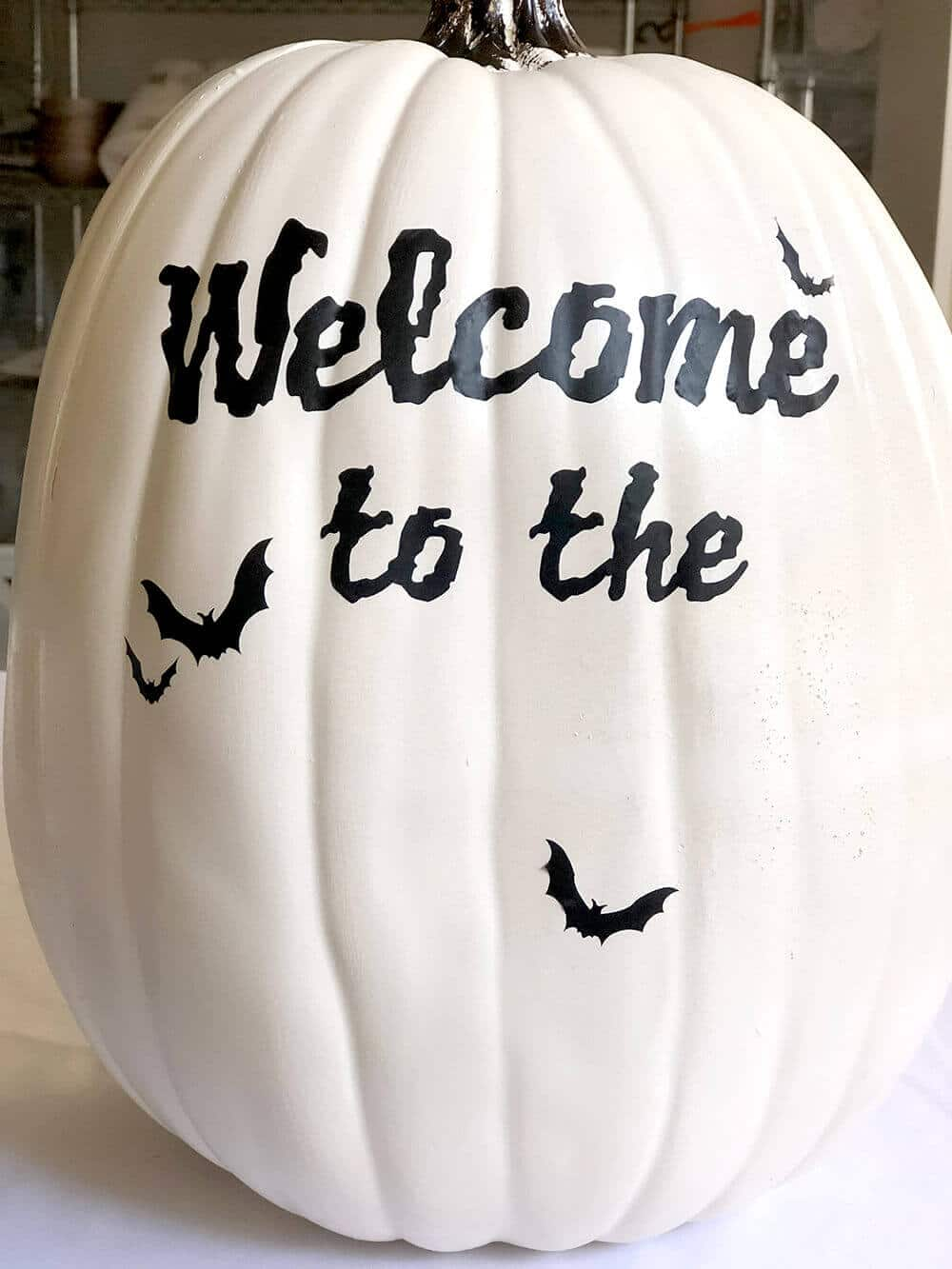 White pumpkin with Cricut craft Haunted hollow svg