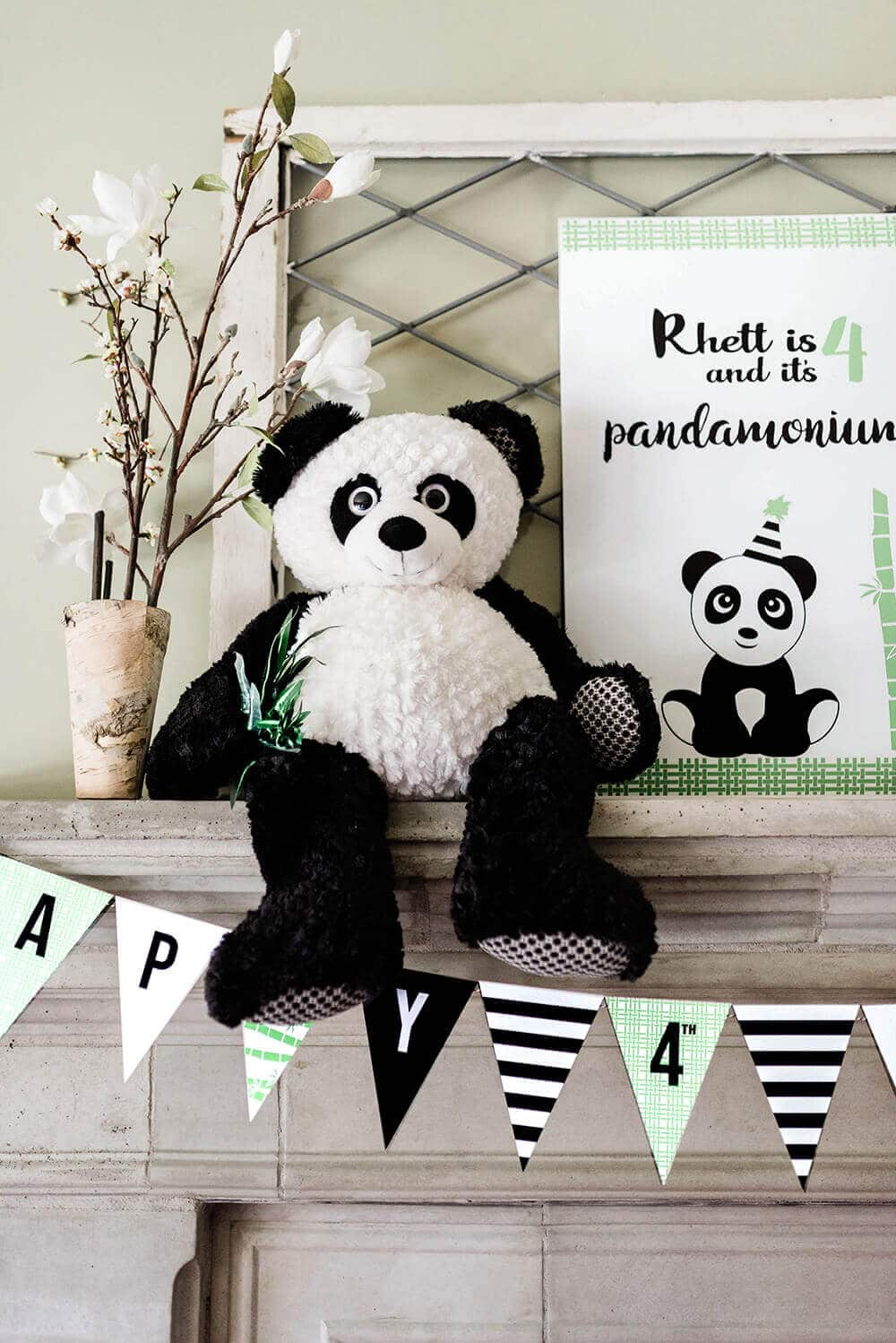 Giant plush panda as decor on mantel for panda party